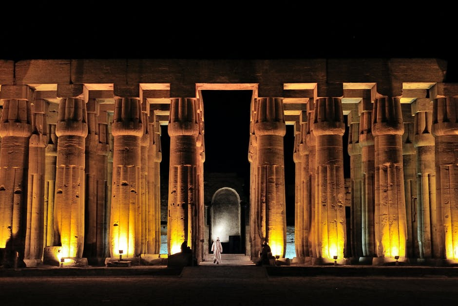 A large building in the background with Luxor Temple in the background